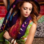 Studio portrait of caucasian young woman wearing colorful scarves. Ethnic fashion concept.